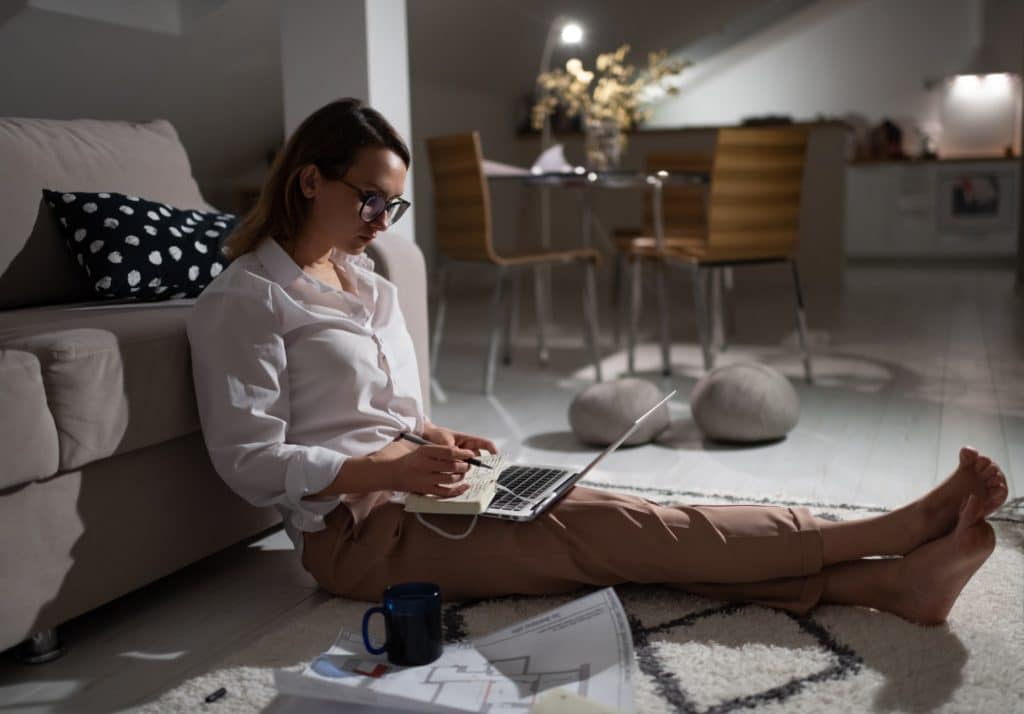 Busy woman working remotely from home